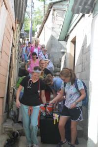 Volunteers Carrying Medical Supplies